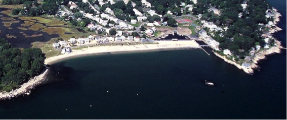 pocket beach aerial photo showing indented beach surrounded by rocky land